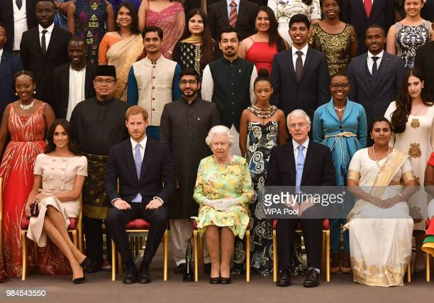 Meghan Duchess of Sussex Prince Harry Duke of Sussex Queen Elizabeth II and John Major at the Queen's Young Leaders Awards Ceremony at Buckingham...