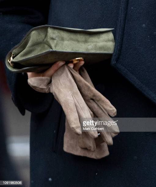 Meghan Duchess of Sussex purse and glove detail visits the Bristol Old Vic and meets members of the public gathered outside on February 1 2019 in...