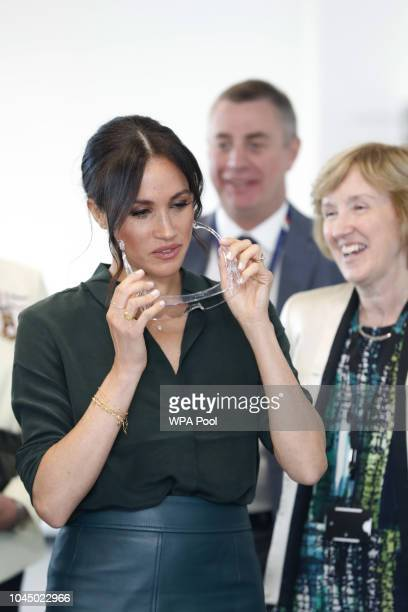 Meghan Duchess of Sussex puts on safety spectacles as she arrives for an engagement at University of Chichester Tech Park during an official visit to...