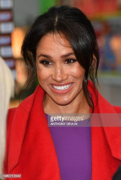 Meghan Duchess of Sussex reacts as she officially opens 'Number 7' a 'Feeding Birkenhead' citizens' supermarket and community cafe during her visit...