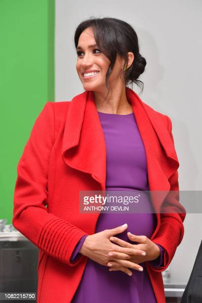 Meghan, Duchess of Sussex, reacts as she officially opens 'Number 7', a 'Feeding Birkenhead' citizens' supermarket and community cafe, during her...