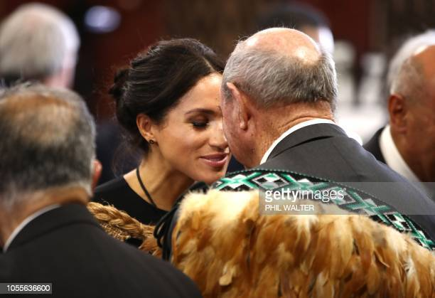 Meghan Duchess of Sussex receives a hongi or traditional Maori greeting on a visit to Te Papaiouru marae in Rotorua on October 31 2018 The Duke and...