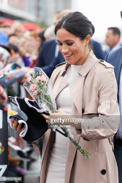 Meghan Duchess of Sussex recieves black and white all black baby outfit from fans during 'Walkabout' on October 30 2018 in Auckland New Zealand The...
