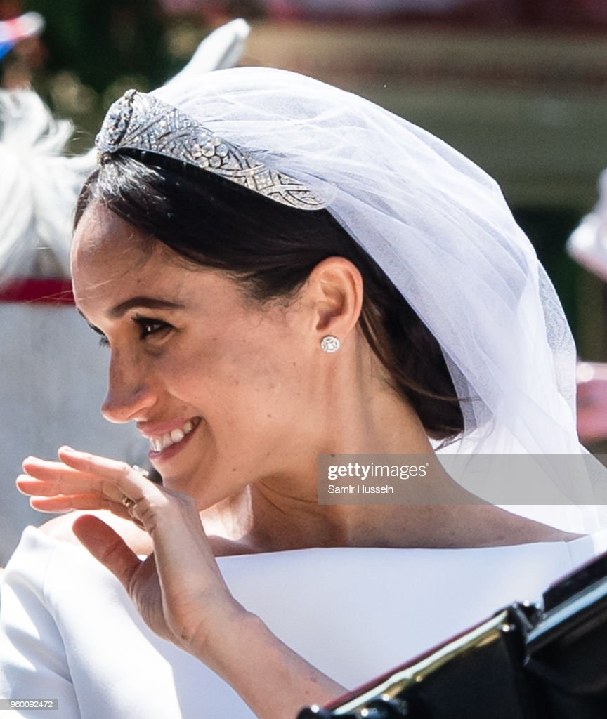 Meghan, Duchess of Sussex rides in the Ascot Landau carriage during the procession after getting married at St George's Chapel, Windsor Castle on May 19, 2018 in Windsor, England. Prince Henry Charles Albert David of Wales marries Ms. Meghan Markle in a service at St George's Chapel inside the grounds of Windsor Castle. Among the guests were 2200 members of the public, the royal family and Ms. Markle's Mother Doria Ragland.