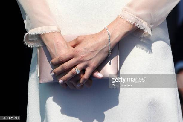 Meghan Duchess of Sussex ring and purse detail attends The Prince of Wales' 70th Birthday Patronage Celebration held at Buckingham Palace on May 22...