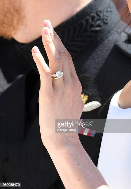 Meghan Duchess of Sussex ring detail leaves Windsor Castle in the Ascot Landau carriage during a procession after getting married at St Georges...