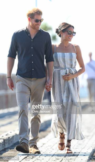 Meghan, Duchess of Sussex seen holding her baby bump whilst Prince Harry, Duke of Sussex and Meghan, Duchess of Sussex walk along a wharf in...