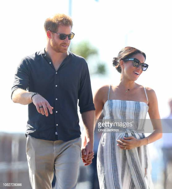 Meghan Duchess of Sussex seen holding her baby bump whilst Prince Harry Duke of Sussex and Meghan Duchess of Sussex walk along a wharf in Kingfisher...