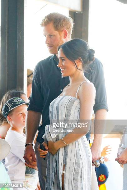 Meghan Duchess of Sussex seen holding her baby bump whilst Prince Harry Duke of SussexÊandÊMeghan Duchess of Sussex talk to fans in Kingfisher bay on...