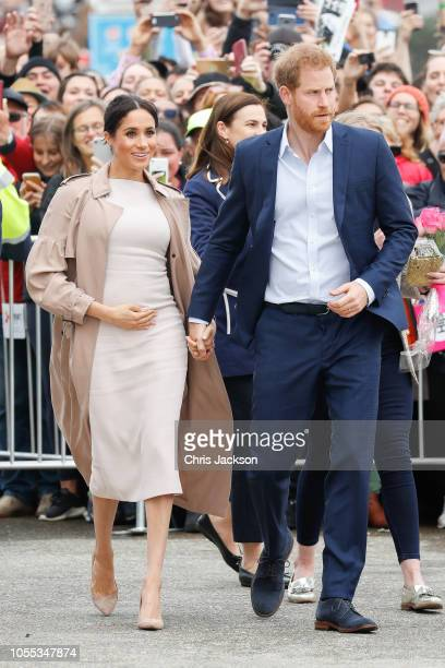 Meghan Duchess of Sussex seen wlaking holding baby bump whilst Prince Harry Duke of Sussex and Meghan Duchess of Sussex during the 'Walkabout' on...