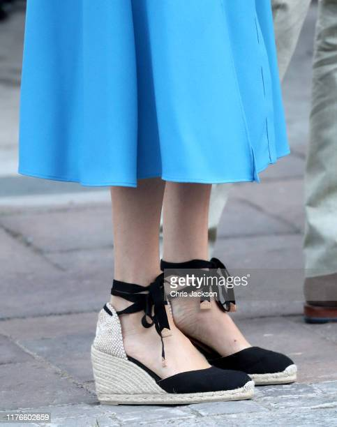 Meghan Duchess of Sussex shoe detail visits the District 6 Museum and Homecoming Centre with Prince Harry Duke of Sussex during their royal tour of...