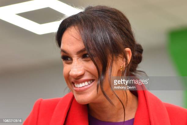 Meghan Duchess of Sussex smiles as the Duke and Duchess of Sussex officially open Number 7 a Feeding Birkenhead citizens supermarket and community...