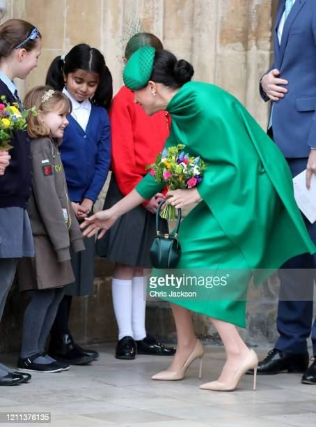 Meghan Duchess of Sussex speaks to a young wellwisher as she departs the Commonwealth Day Service 2020 at Westminster Abbey on March 09 2020 in...
