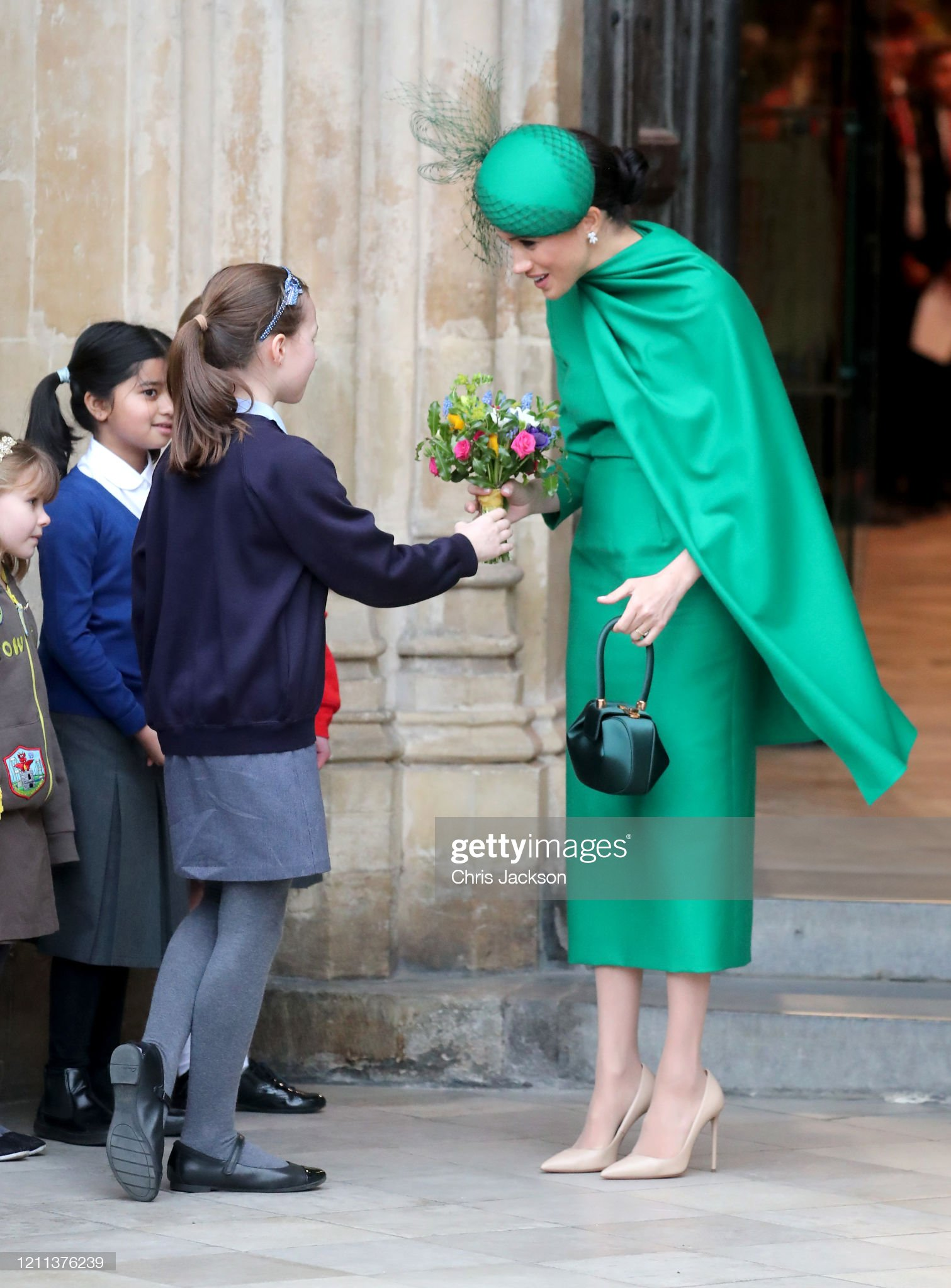 https://media.gettyimages.com/photos/meghan-duchess-of-sussex-speaks-to-a-young-wellwisher-as-she-departs-picture-id1211376239?s=2048x2048