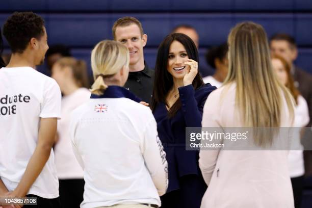 Meghan Duchess of Sussex speaks to graduates as she attends the Coach Core Awards held at Loughborough University on September 24 2018 in...