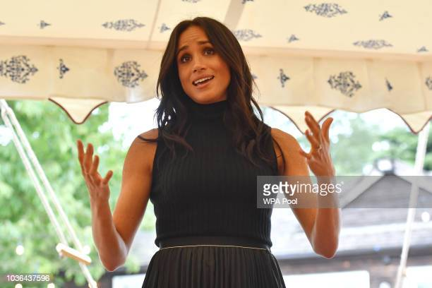 Meghan Duchess of Sussex speaks to guests during an event to mark the launch of a cookbook with recipes from a group of women affected by the...