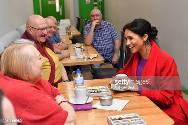 Meghan Duchess of Sussex speaks with locals at 'Number 7' a 'Feeding Birkenhead' citizen's supermarket and community cafe on January 14 2019 in...