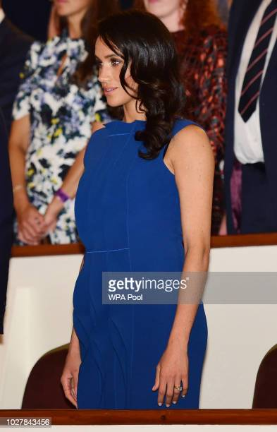 Meghan Duchess of Sussex stands for the National Anthem ahead of the '100 days of peace' concert to commemorate the centenary of the end of the First...