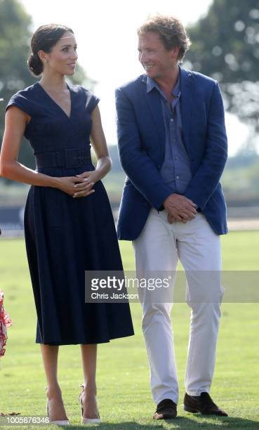 Meghan Duchess of Sussex stands with Sentebale Chairman Johnny Hornby during the Sentebale Polo 2018 held at the Royal County of Berkshire Polo Club...