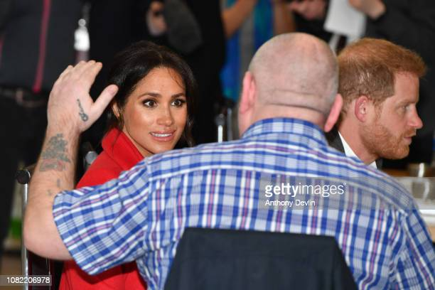 Meghan Duchess of Sussex talks to local people at 'Number Seven' a 'Feeding Birkenhead' citizen's supermarket and community cafe on January 14 2019...