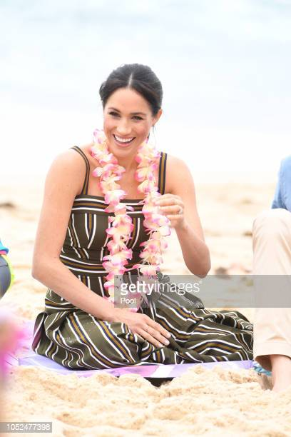Meghan Duchess of Sussex talks to members of OneWave an awareness group for mental health and wellbeing at South Bondi Beach on October 19 2018 in...