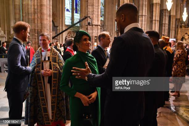 Meghan Duchess of Sussex talks with British boxer Anthony Joshua as she leaves after attending the Commonwealth Day Service 2020 on March 9 2020 in...