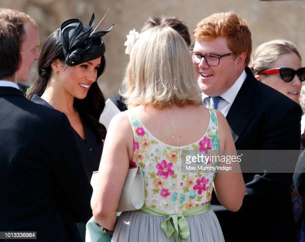 Meghan Duchess of Sussex talks with Celia McCorquodale and George Woodhouse as she attends the wedding of Charlie van Straubenzee and Daisy Jenks at...