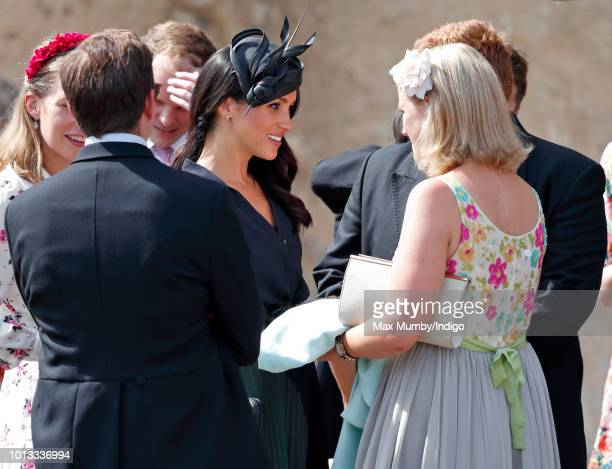 Meghan Duchess of Sussex talks with Celia McCorquodale as she attends the wedding of Charlie van Straubenzee and Daisy Jenks at the church of St Mary...