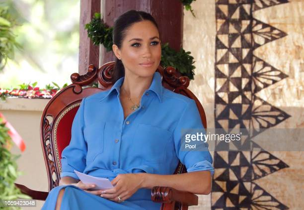 Meghan, Duchess of Sussex talks with students during a visit to Tupou College in Tonga on October 26, 2018. Prince Harry and his wife Meghan are on...