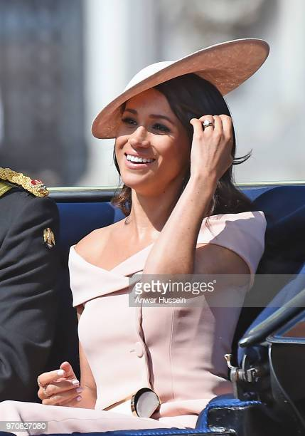 Meghan Duchess of Sussex travel sin an open carriage to the Trooping the Colour ceremony on June 09 2018 in London England