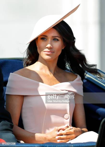 Meghan Duchess of Sussex travels down The Mall in a horse drawn carriage during Trooping The Colour 2018 on June 9 2018 in London England The annual...