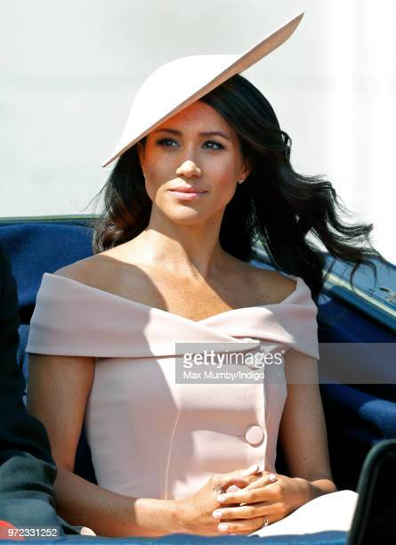 Meghan, Duchess of Sussex travels down The Mall in a horse drawn carriage during Trooping The Colour 2018 on June 9, 2018 in London, England. The...
