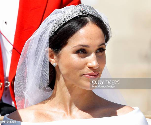 Meghan Duchess of Sussex travels in an Ascot Landau carriage as she Prince Harry Duke of Sussex begin their procession through Windsor following...
