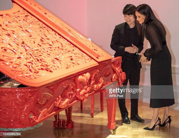 Meghan Duchess of Sussex views an exhibit as she opens 'Oceania' at Royal Academy of Arts on September 25 2018 in London England 'Oceania' is the...