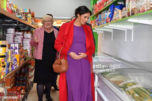 Meghan Duchess of Sussex views produce displayed for sale as she officially opens 'Number 7' a 'Feeding Birkenhead' citizens' supermarket and...