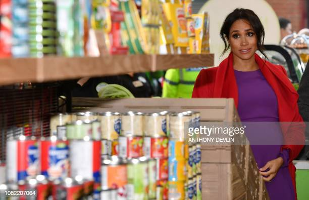 Meghan Duchess of Sussex views products displayed for sale as she officially opens 'Number 7' a 'Feeding Birkenhead' citizens' supermarket and...