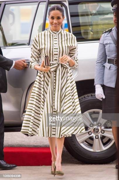 Meghan Duchess of Sussex visits an exhibition of Tongan handicrafts mats and tapa cloths at the Fa'onelua Convention Centre on October 26 2018 in...