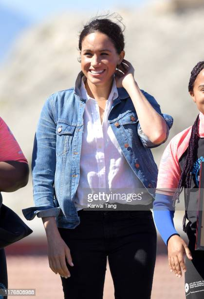 Meghan Duchess of Sussex visits Monwabisi Beach with Prince Harry Duke of Sussex where they learn about the work of 'Waves for Change' during day two...