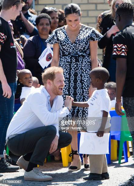 Meghan Duchess of Sussex visits the Nyanga Township with Prince Harry Duke of Sussex during their royal tour of South Africa on September 23 2019 in...