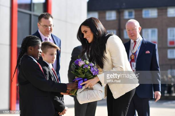Meghan Duchess of Sussex visits the the Robert Clack Upper School in Dagenham to attend a special assembly ahead of International Women's Day held on...