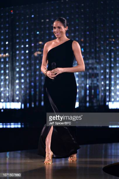 Meghan Duchess of Sussex walks on stage during The Fashion Awards 2018 In Partnership With Swarovski at Royal Albert Hall on December 10 2018 in...