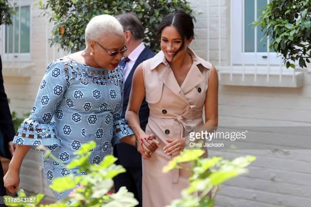 Meghan Duchess of Sussex walks with Graca Machel widow of the late Nelson Mandela on October 02 2019 in Johannesburg South Africa The Duke last met...