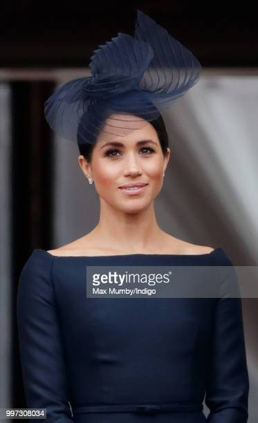 Meghan, Duchess of Sussex watches a flypast to mark the centenary of the Royal Air Force from the balcony of Buckingham Palace on July 10, 2018 in...