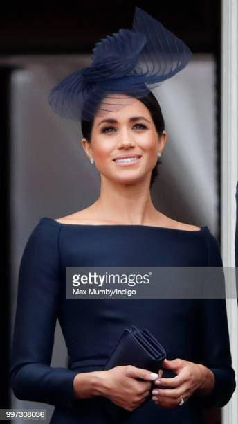 Meghan Duchess of Sussex watches a flypast to mark the centenary of the Royal Air Force from the balcony of Buckingham Palace on July 10 2018 in...