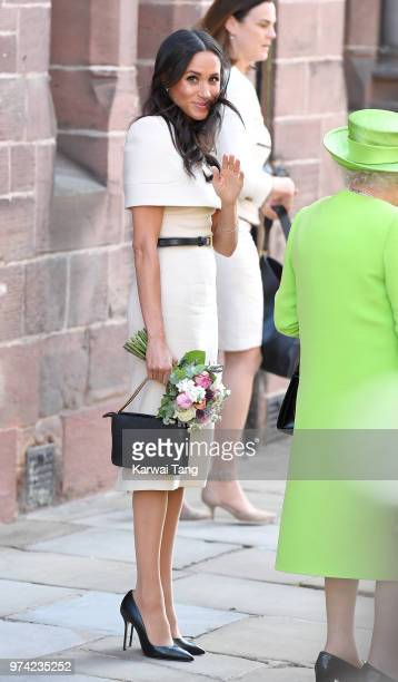 Meghan Duchess of Sussex waves as she departs Chester Town Hall where the Duchess and Queen Elizabeth II attended lunch as guests of Chester City...