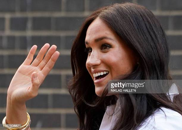 Meghan Duchess of Sussex waves as she leaves after launching the Smart Works capsule collection in London on Septemeber 12 2019 Created in September...
