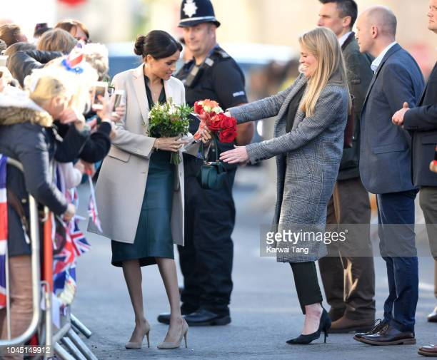 Meghan Duchess of Sussex with her assistant Amy Pickerill during an official visit to Sussex on October 3 2018 in Chichester United Kingdom The Duke...