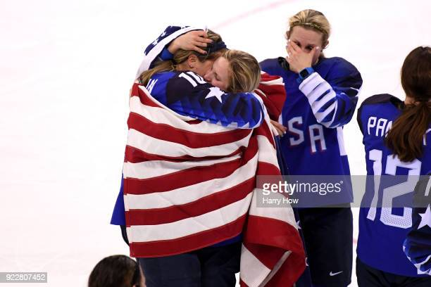 Meghan Duggan hugs Gigi Marvin of the United States as they celebrate after defeating Canada in a shootout to win the Women's Gold Medal Game on day...