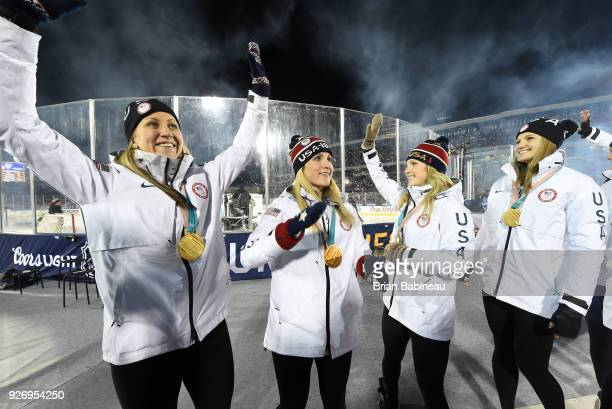 Meghan Duggan Monique LamoureuxMorando Amanda Kessel and Lee Stecklein of the 2018 United States Women's National Hockey Team wave to the stadium...