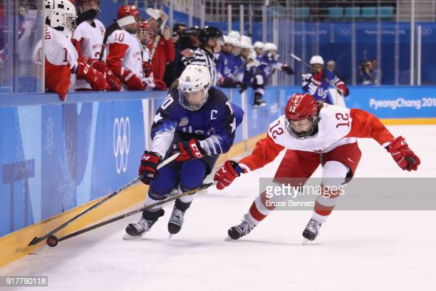Meghan Duggan of the United States and Yekaterina Lobova of Olympic Athlete from Russia compete for the puck in the third period during the Women's...